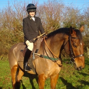 Sarah White at a hunt meet on a bay horse